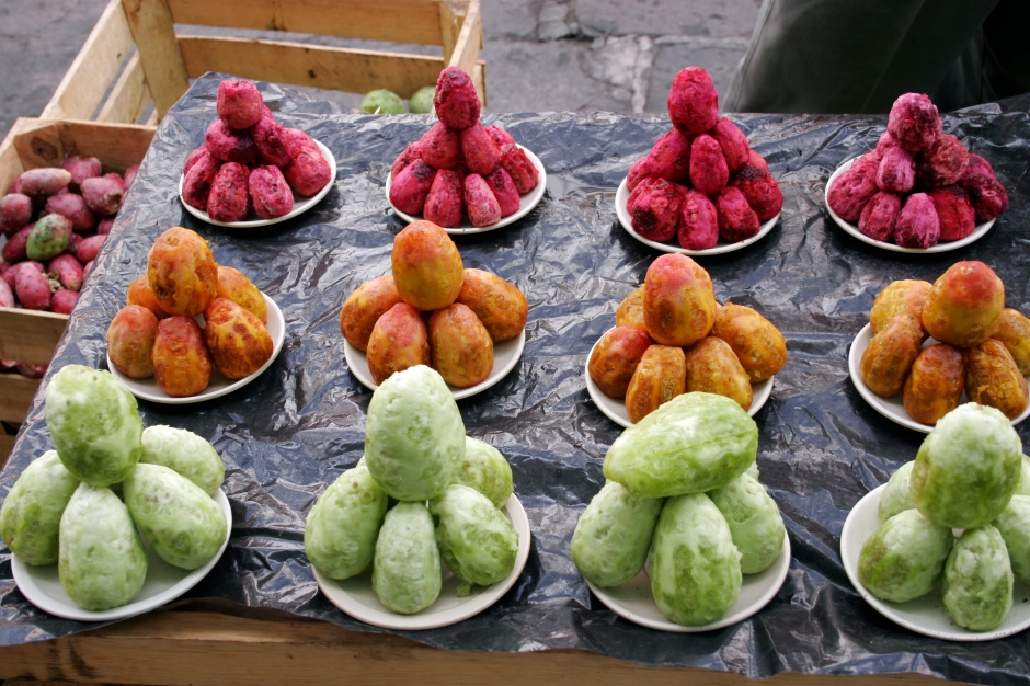 Prickly pear varieties at a market stand.